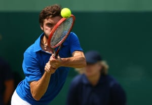 Simon plays a backhand return on his way to a straightforward win in straight sets.