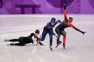 Great Britain's Elise Christie crosses the line in first place as Canada's Kim Boutin and Hungary 's Andrea Keszler fall during the women's 500m short track speed skating quarterfinal.