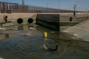 Dilan Rodríguez, 8, fishing in the canal that runs adjacent to the dry Colorado River at the border of Mexico and the US on 6 September 2019.