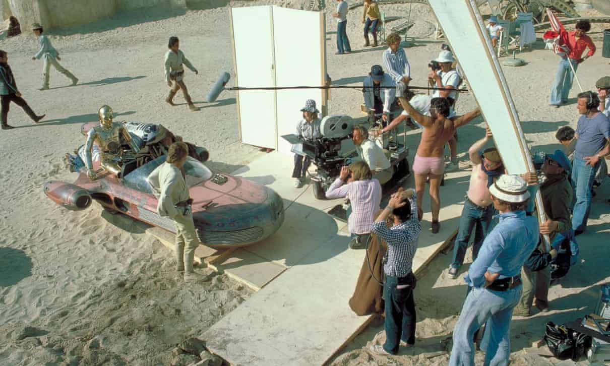 Ken Nightingall, holding boom mike and wearing pink shorts on the set of Star Wars