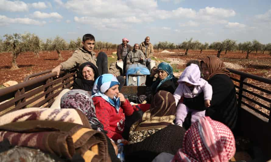 Kurdish civilians flee Afrin in northern Syria after Turkey said its army and allied rebel groups had surrounded the city, March 2018