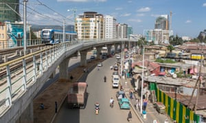 New infrastructure alongside a slum area in Addis Ababa, capital of debt-laden Ethiopia.