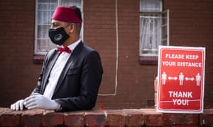 A community member wears his face mask during a food handout in Coronation on day 59 of the national lockdown as a result of Covid-19 Coronavirus, in Johannesburg, South Africa, 25 May 2020.