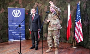 The Polish defense minister and the commander of the US army in Europe hold a press conference in Poland on Wednesday.