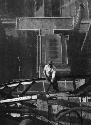 High-angle view of a worker sitting on a steel girder high atop the Chrysler building, on the 54th floor, during its construction in New York