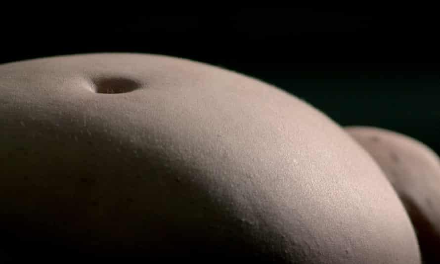 The camera lingers over her naked body, a vast landscape of pale, mottled flesh.