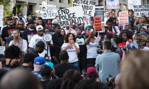 People rally in Dallas, Texas, on 7 July 2016 to protest the deaths of Alton Sterling and Philando Castile.