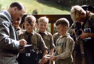 An undated photograph of members of the Hitler Youth surrounding their leader at the Berghof, his holiday retreat in the Bavarian Alps: black and white image coloured by artist Marina Amaral