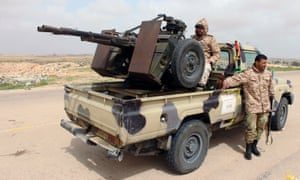 Troops allied to the UN-backed government deploy in Sirte, Libya.