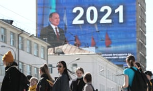 A live broadcast of Russian President Vladimir Putin's annual address to the Federal Assembly of the Russian Federation on the facade of a building in Malysheva Street.