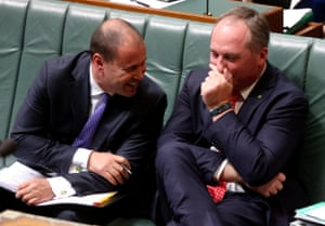 The deputy prime minister, Barnaby Joyce, and the minister for energy, Josh Frydenberg, joke during question time