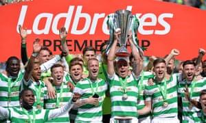Scott Brown lifts the Scottish Premiership trophy after Celtic won their seventh successive title last season.