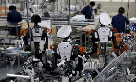 Robots and employees in  Kazo, Japan