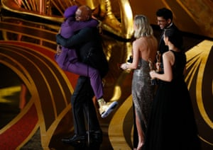 Spike Lee jumps into the arms of presenter Samuel L Jackson as he wins the best adapted screenplay award for BlacKkKlansman