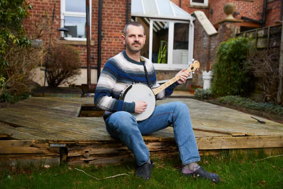Dr Matthew Jackson, an ICU consultant at Stepping Hill Hospital in Stockport, who has learnt to play the banjo at home during lockdown.