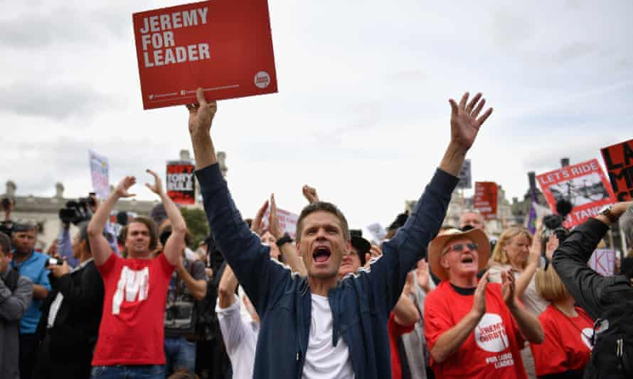 Momentum members rally in support of Jeremy Corbyn.