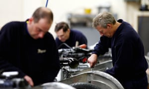 Workers in a UK factory. Manufacturers expect to continue making job cuts through to the autumn.
