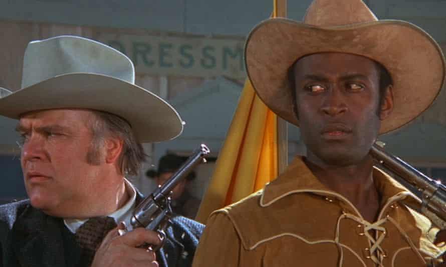 David Huddleston, left, with Cleavon Little, in Blazing Saddles, 1974.