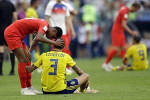 England's Marcus Rashford, left, comforts Sweden's Victor Lindelof.