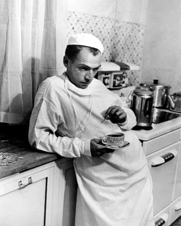 Country doctor Ernest Ceriani photographed after having performed a cesarean section during which both baby and mother died due to complications. The picture, taken in Kremmling, Colorado, was part of Smith's groundbreaking photo essay for Life magazine in 1948.