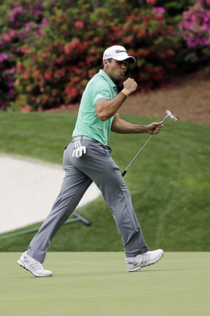 Jason Day punches the air as he's enjoying a good round
