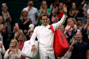 Roger Federer leaves court after winning his first round match against Adrian Mannarino.