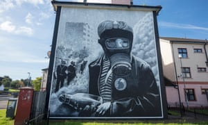 A mural of a petrol bomber in Bogside, Derry. Unresolved crimes from the Troubles have dogged policing and politics.