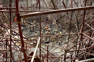 Bangalore, IndiaIndian Fire Brigade and National Disaster Response Force (NDRF) search for survivor at the site of a collapsed water tank which was under-construction as part of a water treatment plant. According to news reports, at least three people were killed and 20 injured when the collapse occurred