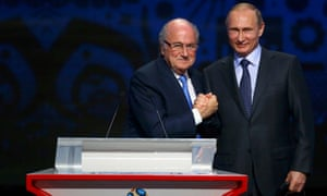 FIFA's President Blatter shakes hands with President Putin