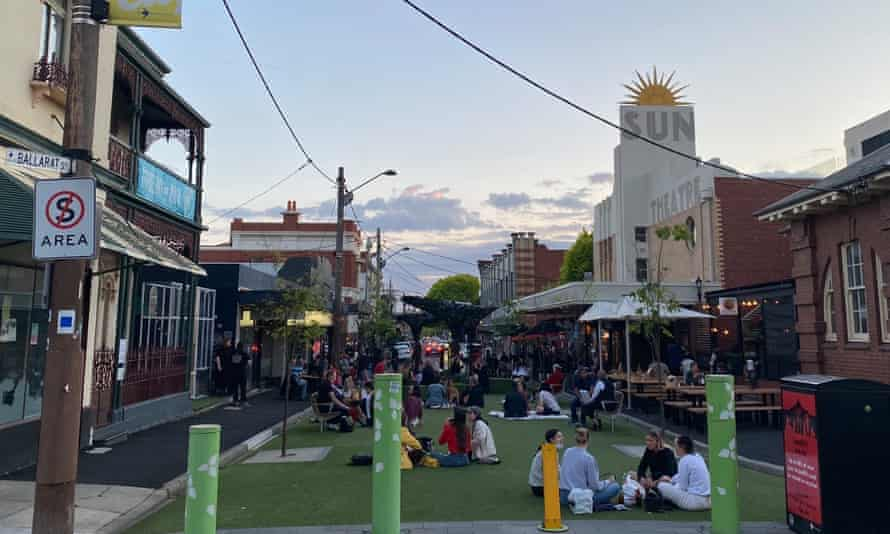 Those who couldn't get a table at bars and restaurants nearby sprawled on the ground at Yarraville's pop-up park