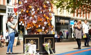 Visitors adding messages of tribute, solidarity and love on one of 28 Japanese maples forming the Trees of Hope trail from Victoria station to St Ann's Square in Manchester