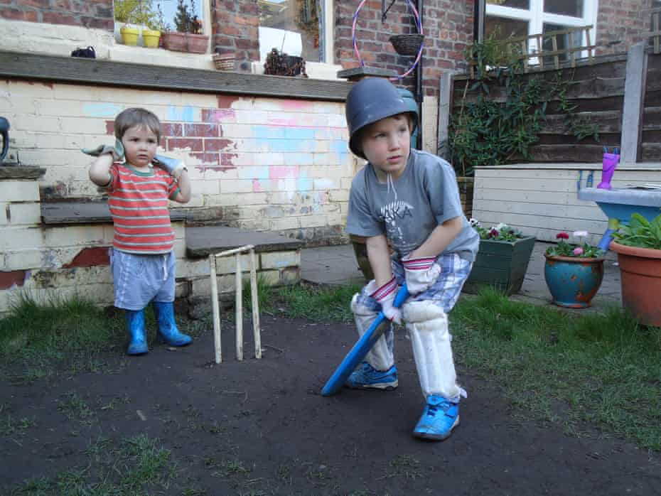Youngster playing cricket in the garden by Tanya Aldred in Manchester in 2011.