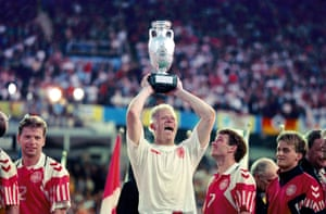 Danish delight: 26 Jun 1992. Denmark's goalkeeper Peter Schmeichel lifts up the European trophy in 1992 after his side beat Germany in the final. Denmark only participated in the eight-team tournament after Yugoslavia was disqualified following the Yugoslav wars.