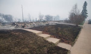 A home entirely burned down in Fort McMurray.