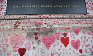 The National Covid Memorial Wall, drawn with red hearts and messages, in London. The wall stands south of the River Thames facing the Houses of Parliament.