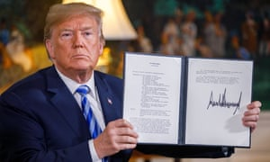 Donald Trump displays the signed presidential memorandum for new sanctions against Iran after announcing the US exit from the Joint Comprehensive Plan of Action on Tuesday.