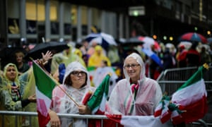 Protesters brave the rain at the 73rd annual Columbus Day parade in New York.