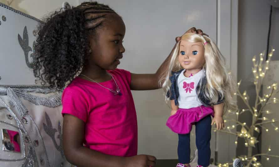 Jayla, aged 4, plays with a My Friend Cayla doll in the Hamleys toy shop in London.