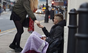 Jason Nash, who is homeless in Brighton, receives money from a stranger