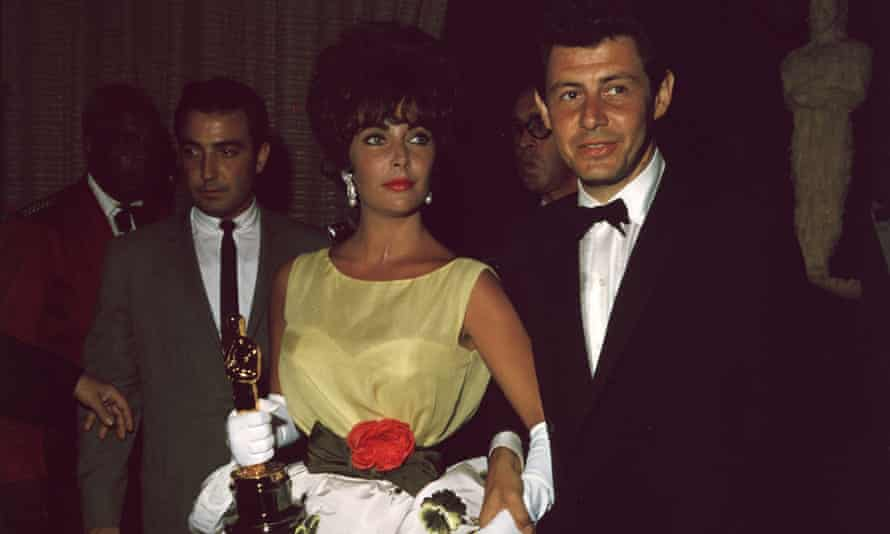 Elizabeth Taylor with her husband Eddie Fisher at the 1961 awards.