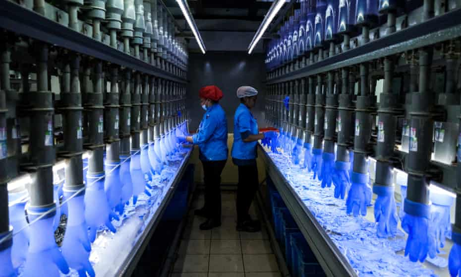 Rubber glove production in factory in Malaysia
