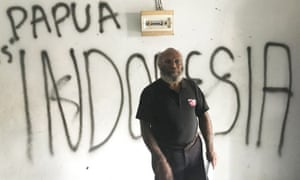 West Papuan customary land owner, Sem Asso, stands inside what was the headquarters for the Timika branch of KNPB, seized by Indonesian authorities in December 2018. It is now covered in pro-Indonesian graffiti.
