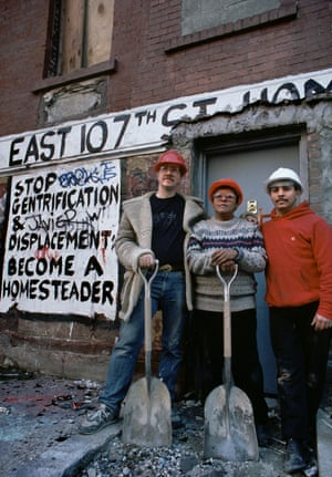 Activists Key Martin and Estela Vasquez with a friend by a 'STOP GENTRIFICATION' banner