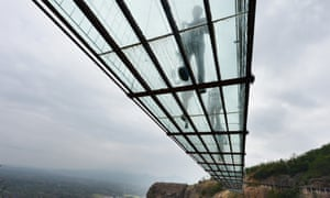 """A view from below. If this bridge isn't terrifying enough for you, just wait until this Autumn, when Hunan province will gain a second glass bridge across the <a href=""""http://edition.cnn.com/2015/05/18/travel/zhangjiajie-glass-bridge/"""">Zhangjiajie Grand Canyon</a>. At 430 meters long and 300 meters high, it will be the longest and highest bridge of its kind in the world."""