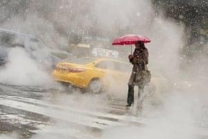 The Storm ArrivesCrossing a steaming street Photograph: Stephen Blumert/GuardianWitness
