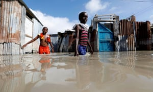Somali children wade through flood waters after heavy rain in Mogadishu.
