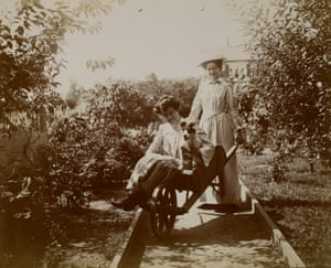 Two women with wheelbarrow, circa 1900