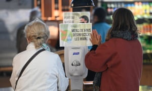 Customers disinfect their hands before entering a cafe in Saint-Grégoire, Rennes, on 11 June.