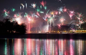 Fireworks are reflected in the Maschsee lake in Hanover