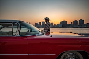 Tokyo, Japan: Hiroyuki Wada, who runs a vintage car service company, stands next to a 1959 Cadillac Coupe DeVille after a gathering of car enthusiasts
